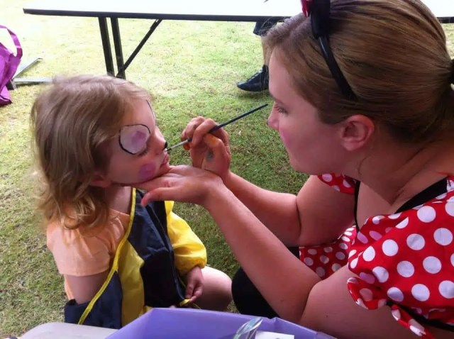 Janine face painting at an event!