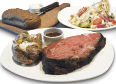 """7) Outback Steakhouse's 16 oz. Herb Roasted Prime Rib (1,400 calories) The 16 oz. prime rib is 1,400 calories alone. For sides, let's say you get the dressed baked potato and the classic blue cheese wedge (it's a """"premium side salad,"""" so it'll cost you a buck), and that you eat just half the loaf of bread and use just a light schmear of butter. The tab: 2,400 calories, 71 grams of sat fat (31⁄2 days' worth), and enough sodium (3,560 mg) for today and tomorrow. IMAGE: CSPI website"""