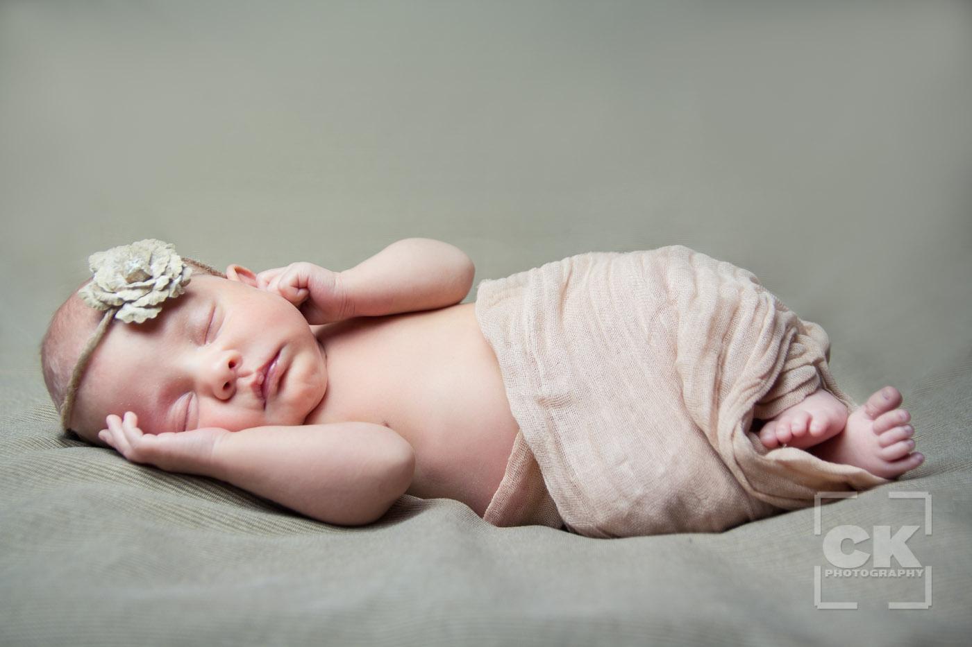Chris Kryzanek Photography - newborn wrapped with flower headband