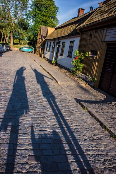 two girls and one small dog shadows
