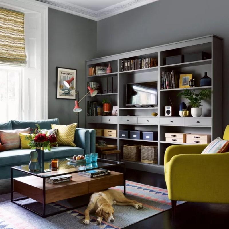 dark grey living room with storage wall unit