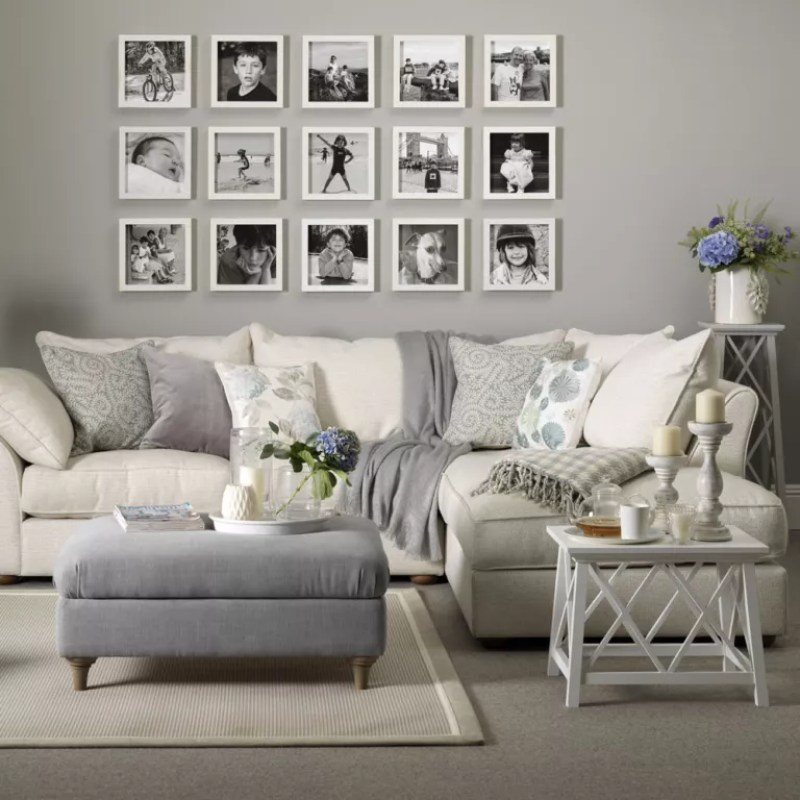 grey living room with gallery wall of black and white photos