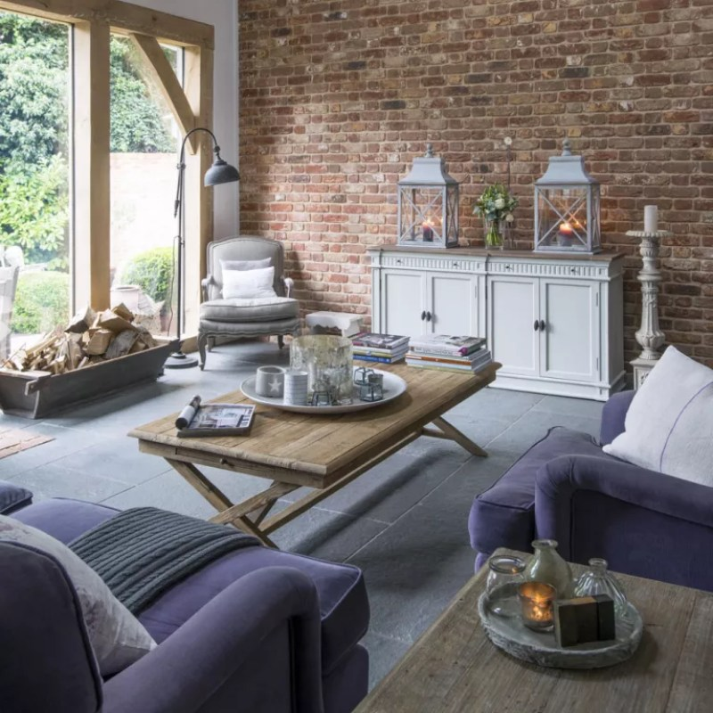 Modern country living room with exposed brick wall