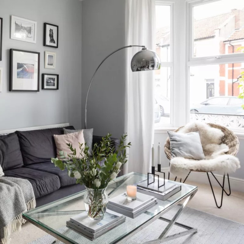 a contemporary style living room in grey and charcoal with sheepskin rugs