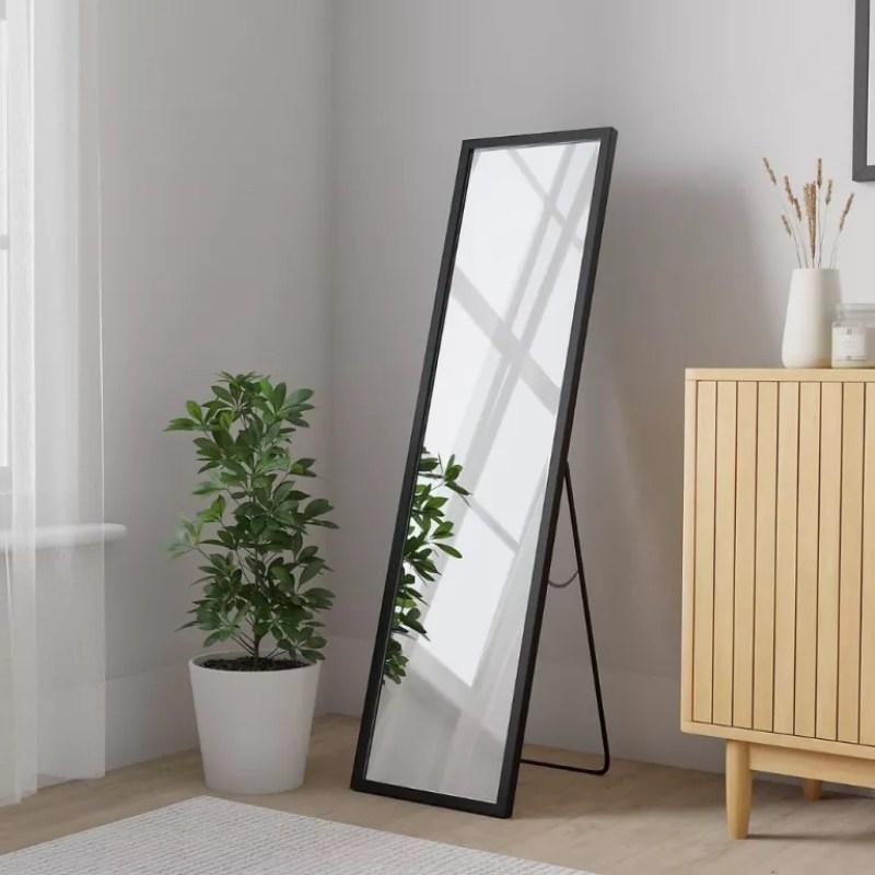 Dunelm Essentials Freestanding Mirror in the corner of a room beside plant