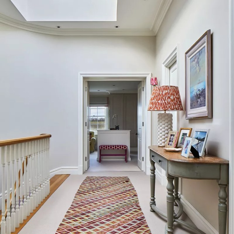 landing with console table and lamp