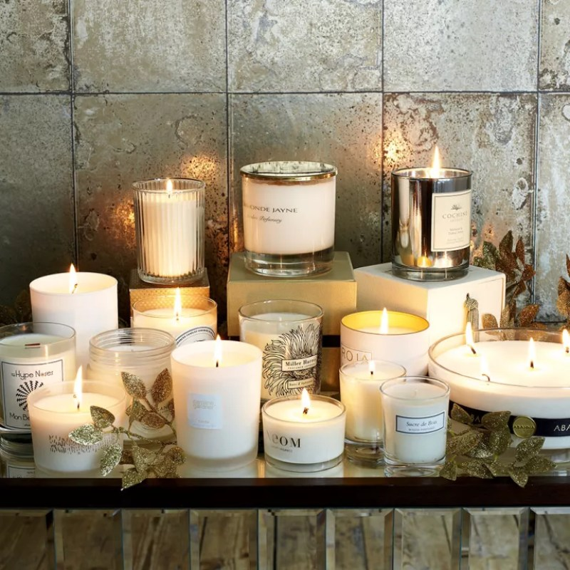 distressed mirrored tiles with lit candles on a shelf