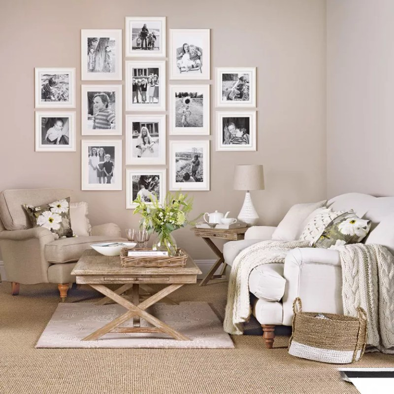 a photo gallery in a living room with lots of natural accents