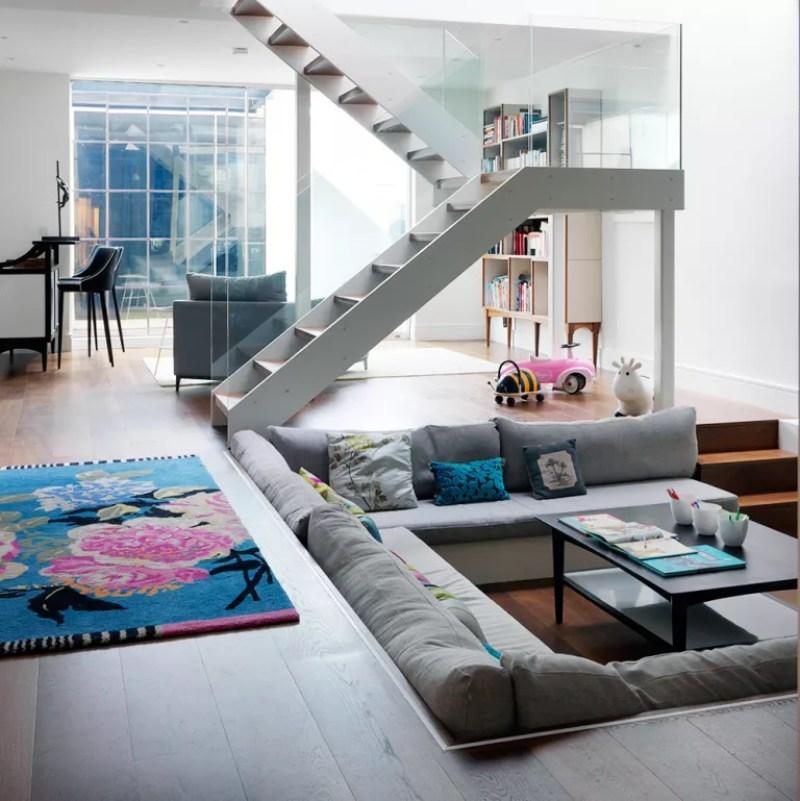 Modern open plan living room with sunken sofa