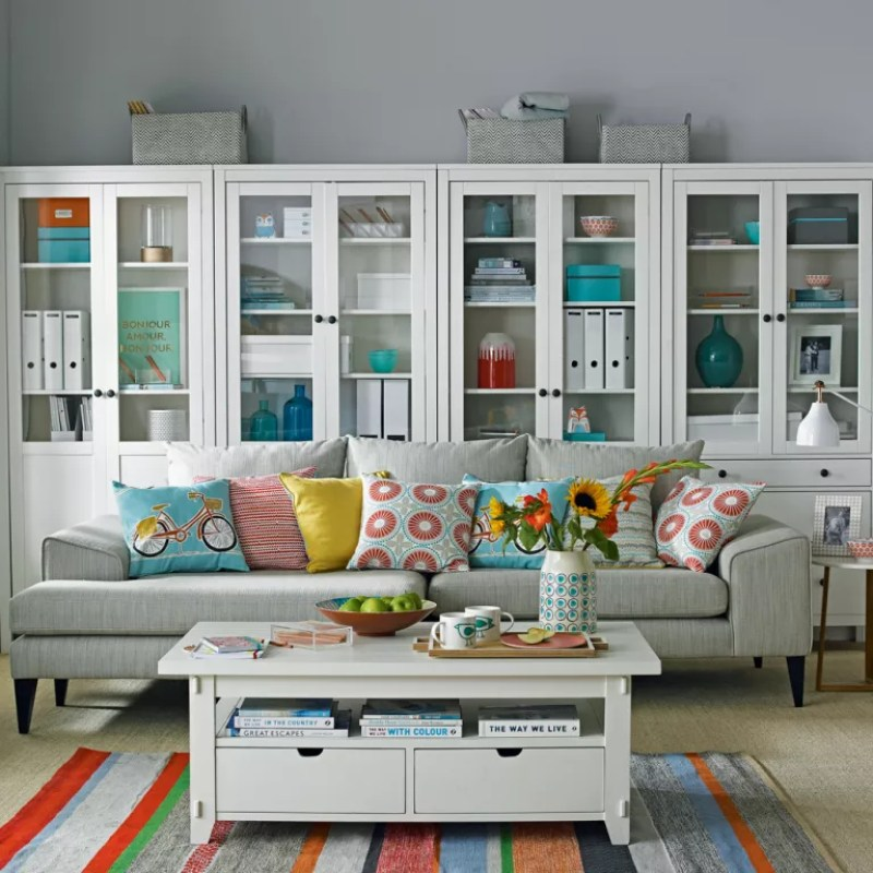 grey living room with white bookcase dressers