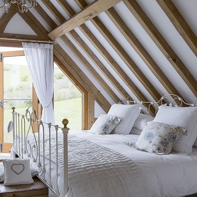 rustic bedroom with exposed wooden beams