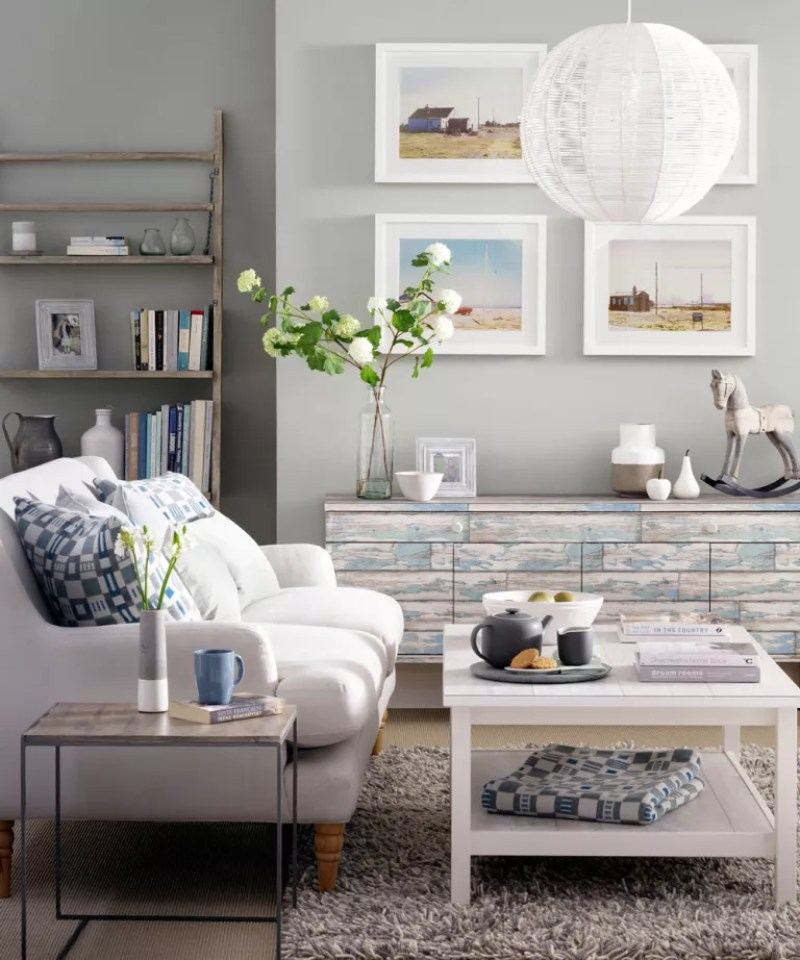 Grey living room with white sofa and weathered wood wallpapered low cabinet