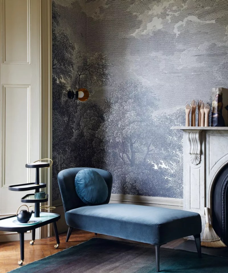 Living room blue trees wallpaper design with blue chaise and original marble fireplace