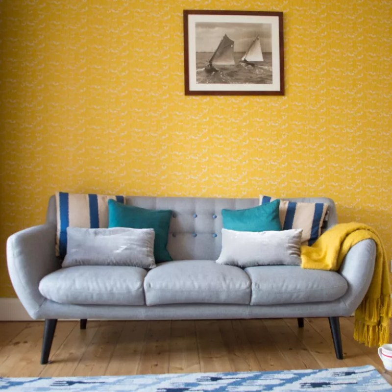Yellow living room with Mid-century furniture and retro print wallpaper