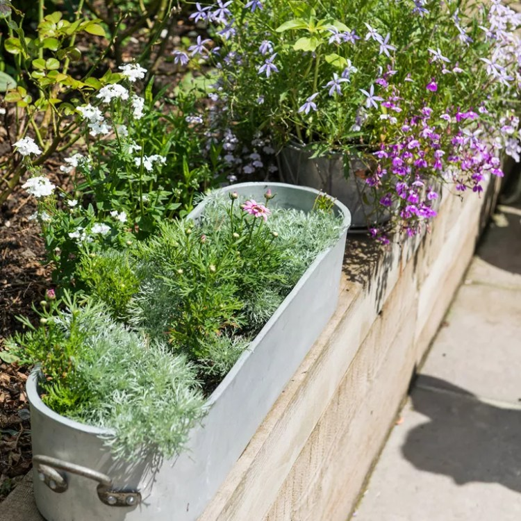 Split-level-garden-makeover-with-plant-packed-borders-7