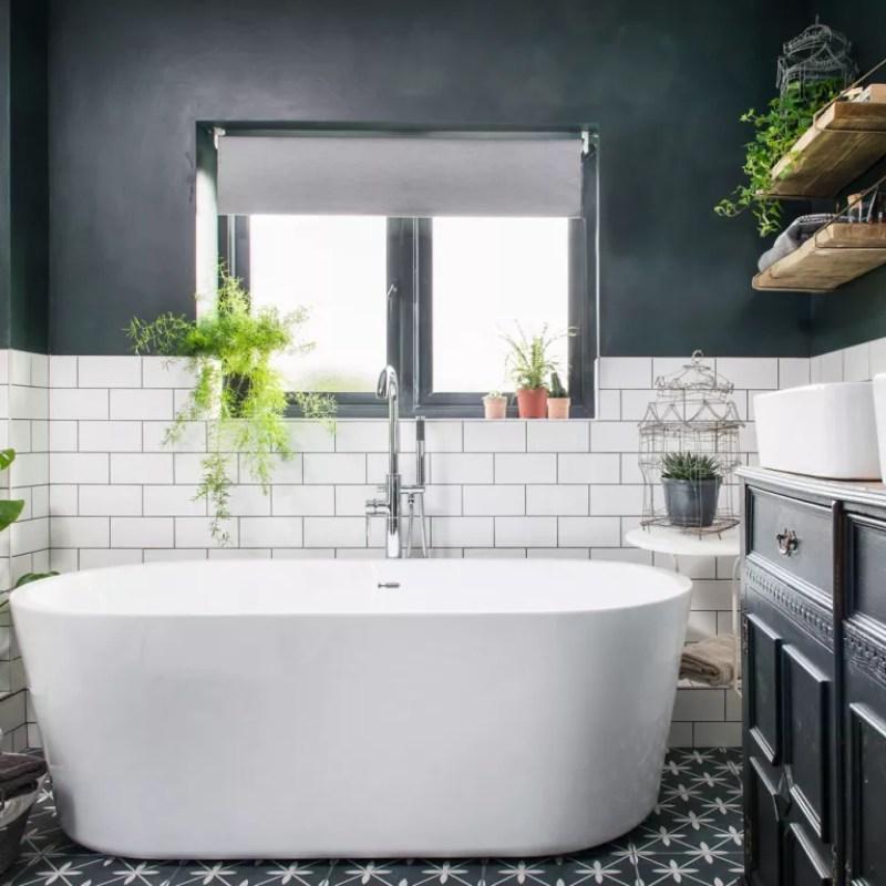 Bathrooms with black walls, white bath and white metro tiles