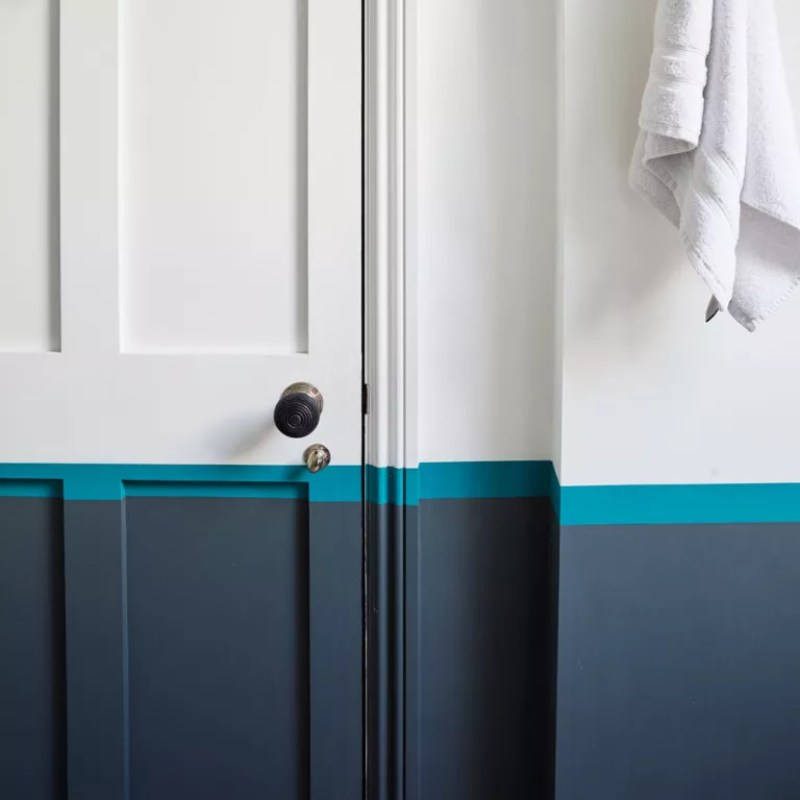 white bathroom with half blue painted wall