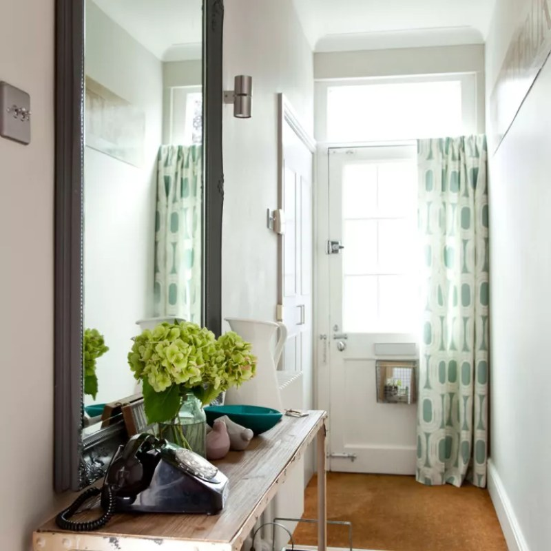 hallway with green patterned door curtain