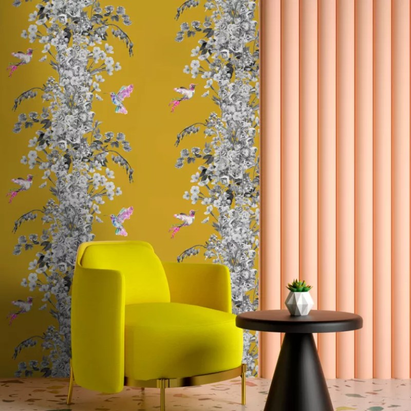 yellow floral wallpaper behind yellow armchair