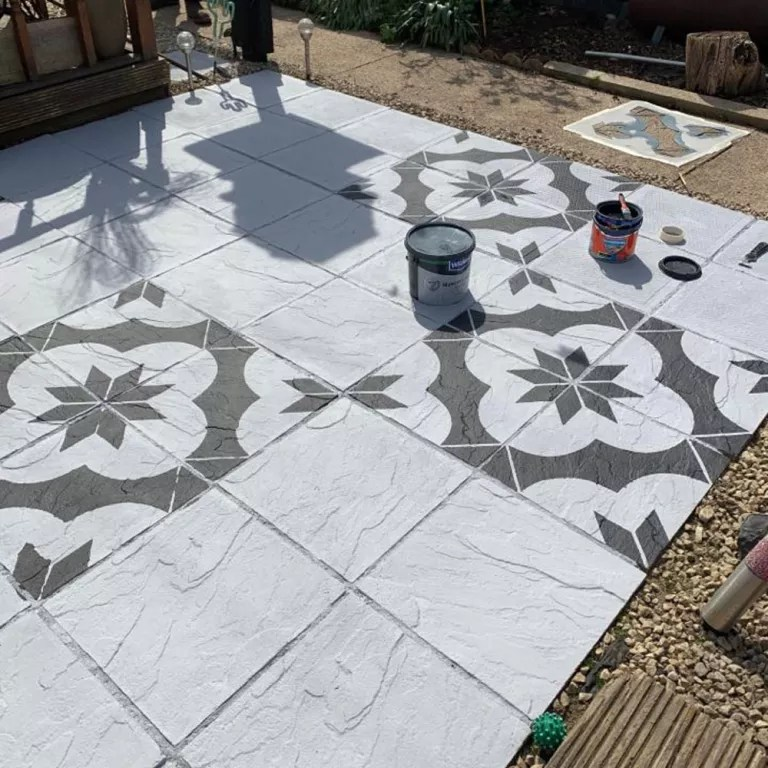 homeowner uses stencil to paint the