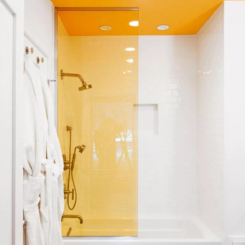 bathroom with yellow ceiling