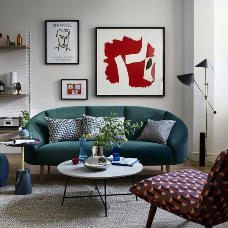 living room with gallery wall, blue sofa, colourful printed chair and shelving - john lewis and partners