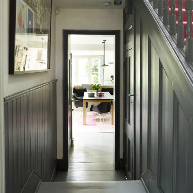 grey hallway with wood panelling