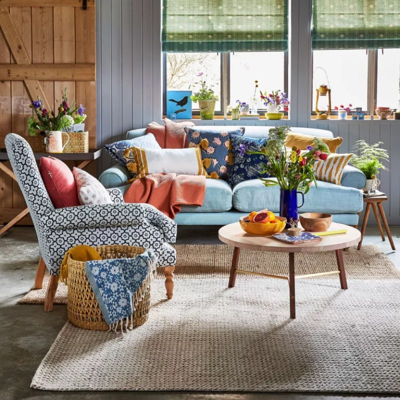 grey living room with blue sofa and armchair
