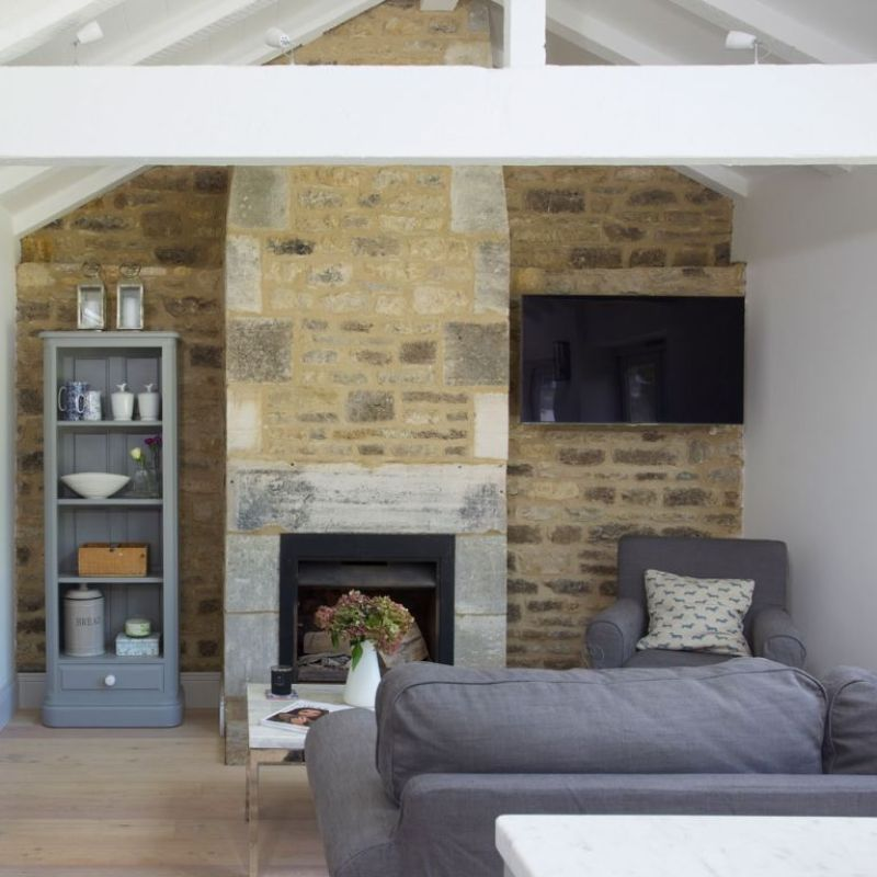 grey living room with stone wall