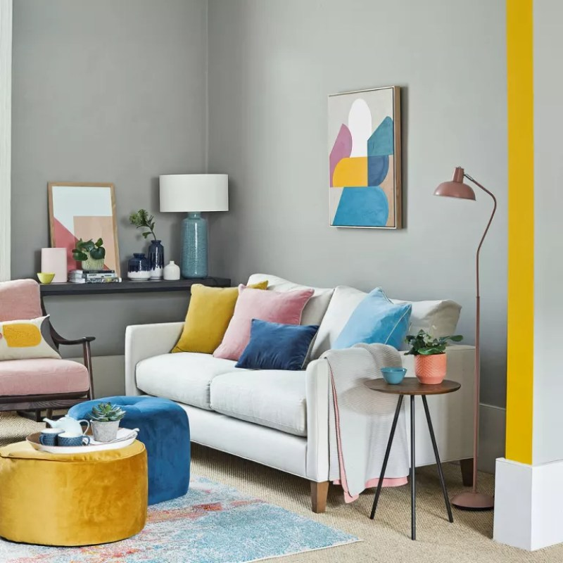 Grey living room with yellow painted archway