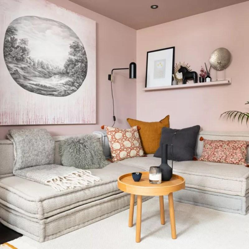 pink living room with corner sofa