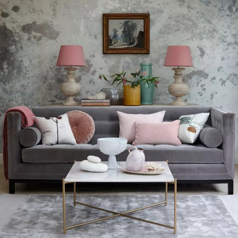 Grey Living room with  textured wallpaper grey velvet sofa and pink table lamps