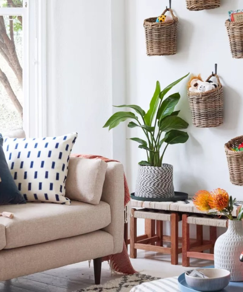 White living room with hanging wall baskets for family storage