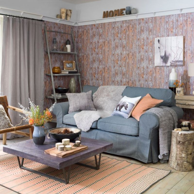 living room with rustic wood wallpaper