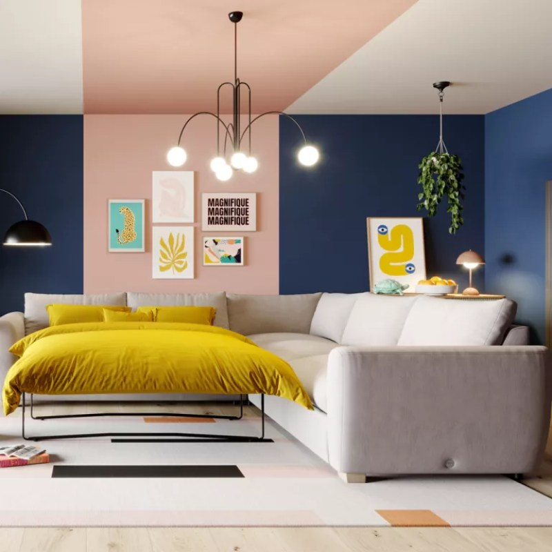 Pink and blue living room with grey sofa bed