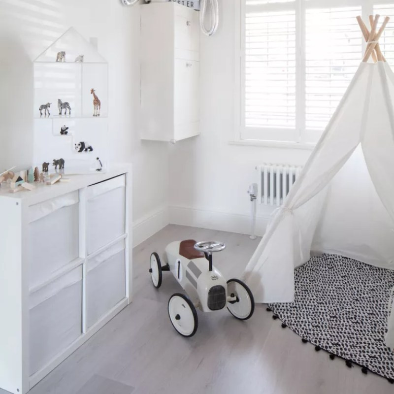 White nursery with teepee tent and toy car