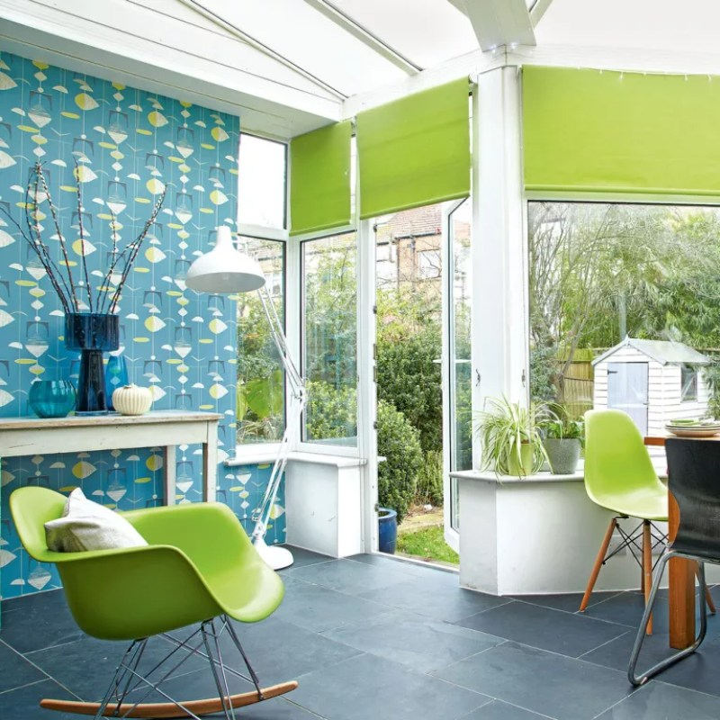 Conservatory with wallpapered feature wall