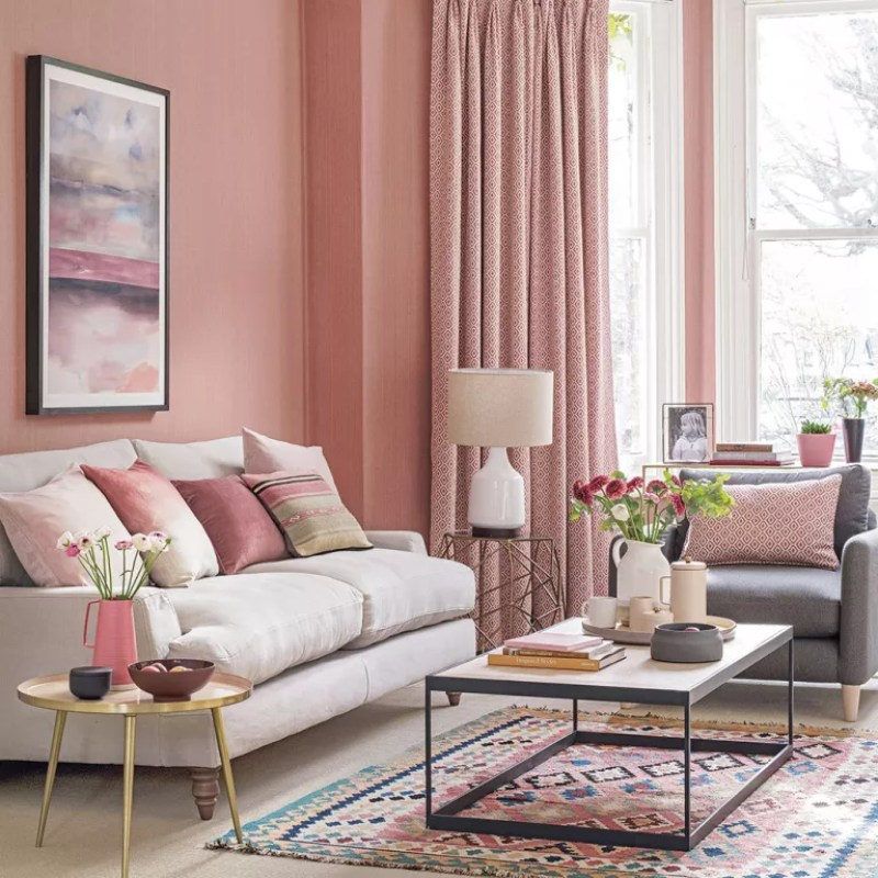 Pink living room with beige sofa on legs and rug