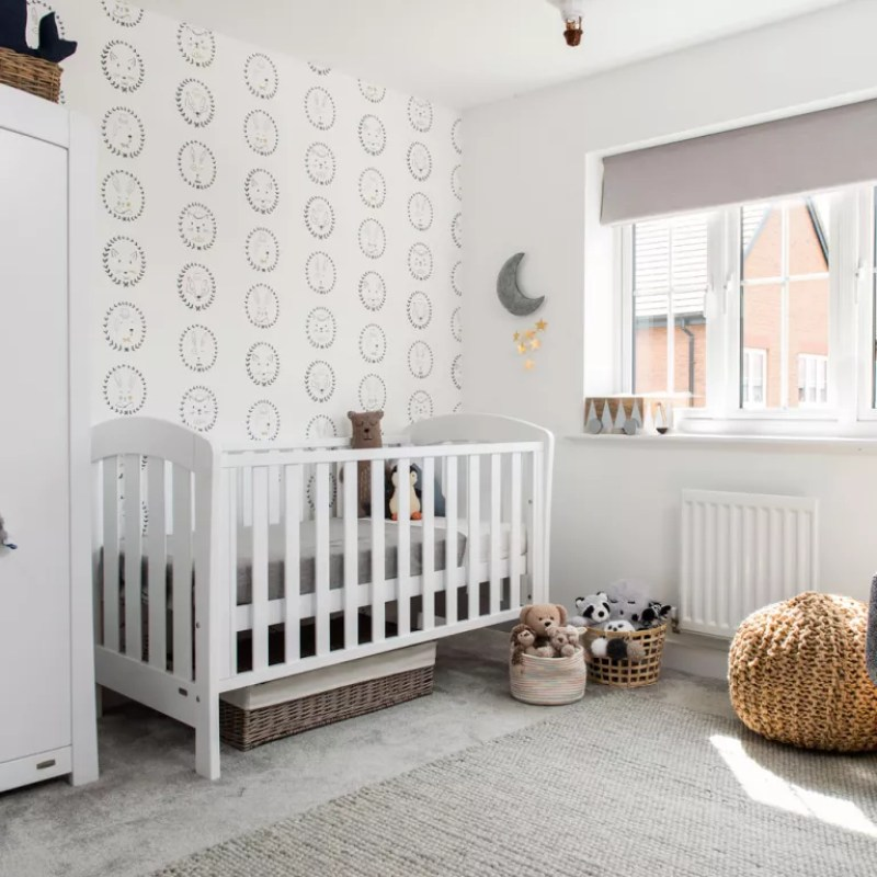 white and grey nursery with subtle patterned wallpaper