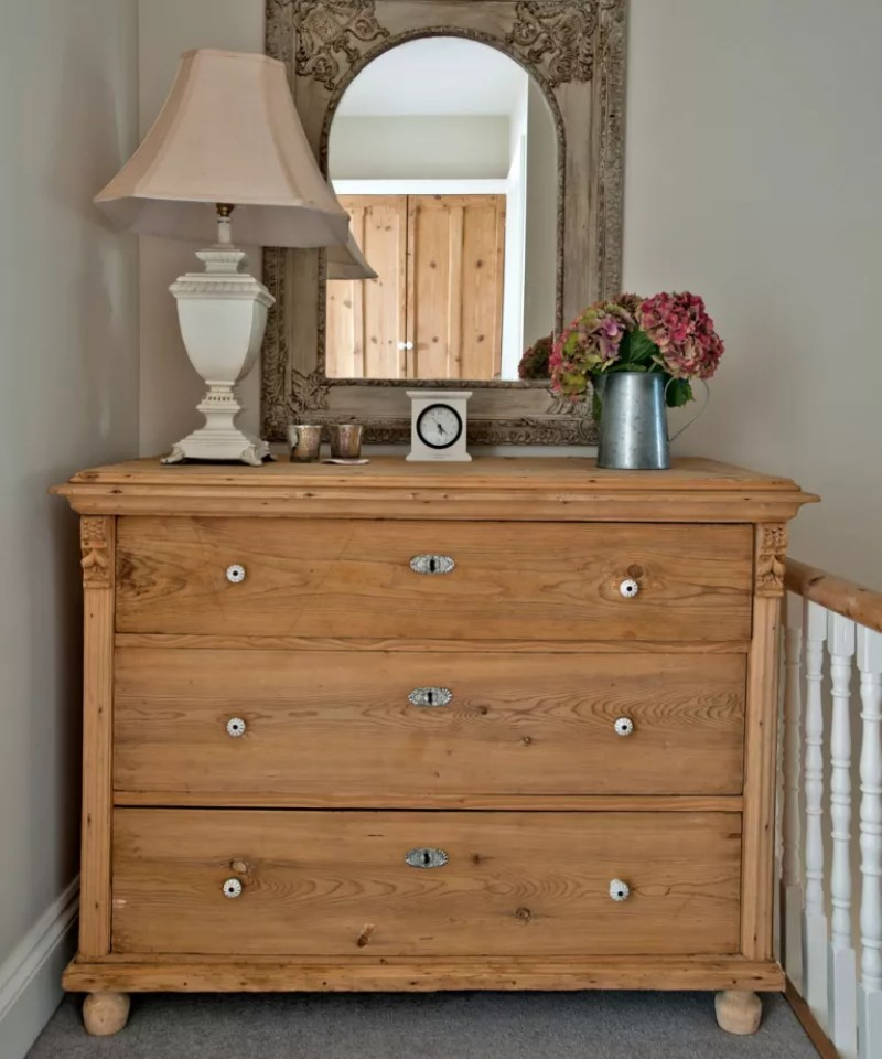Wooden chest of drawers on landing