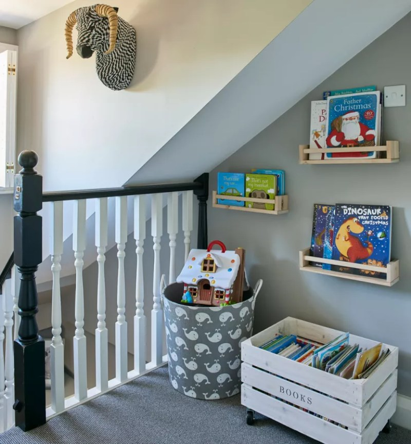 landing with toy storage and book shelves