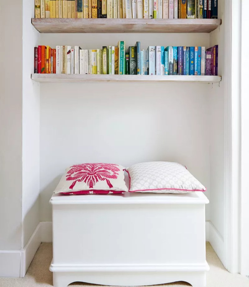 lading area with bookshelves and storage