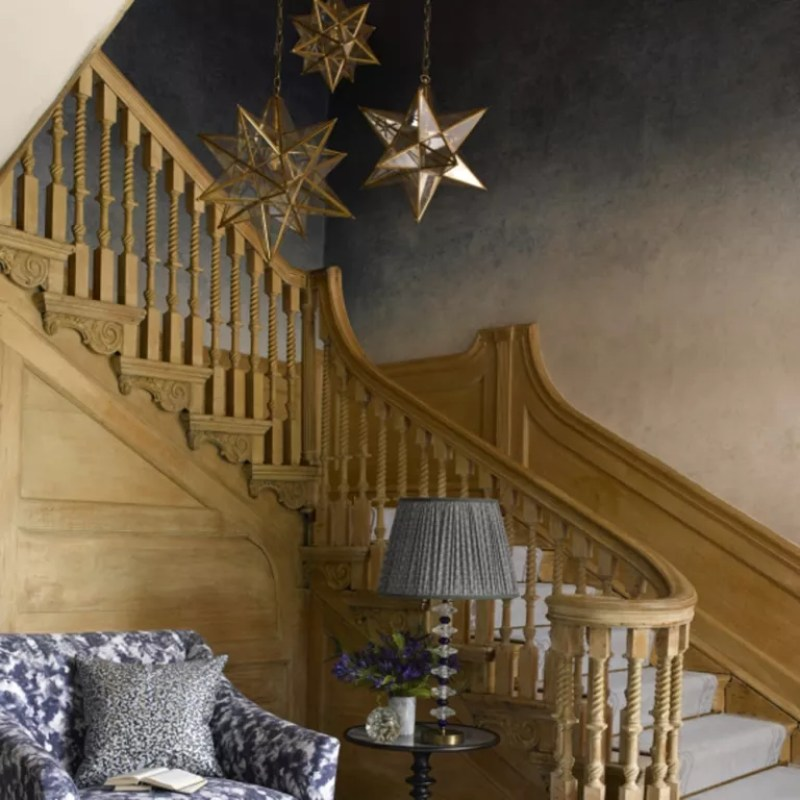 Stella pendant on a staircase with wood banisters from the hallway - pooky