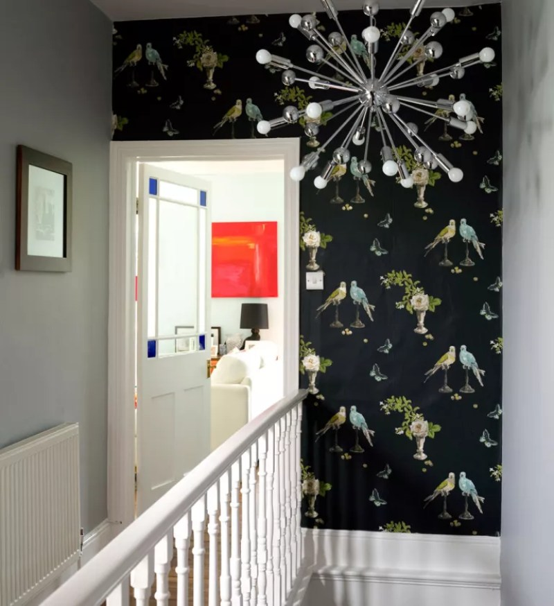 landing with black bird print wallpaper feature wall above stairs