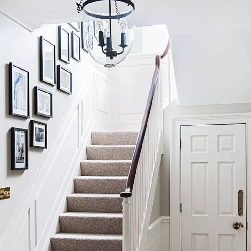 stairway lighting white hallway with picture gallery