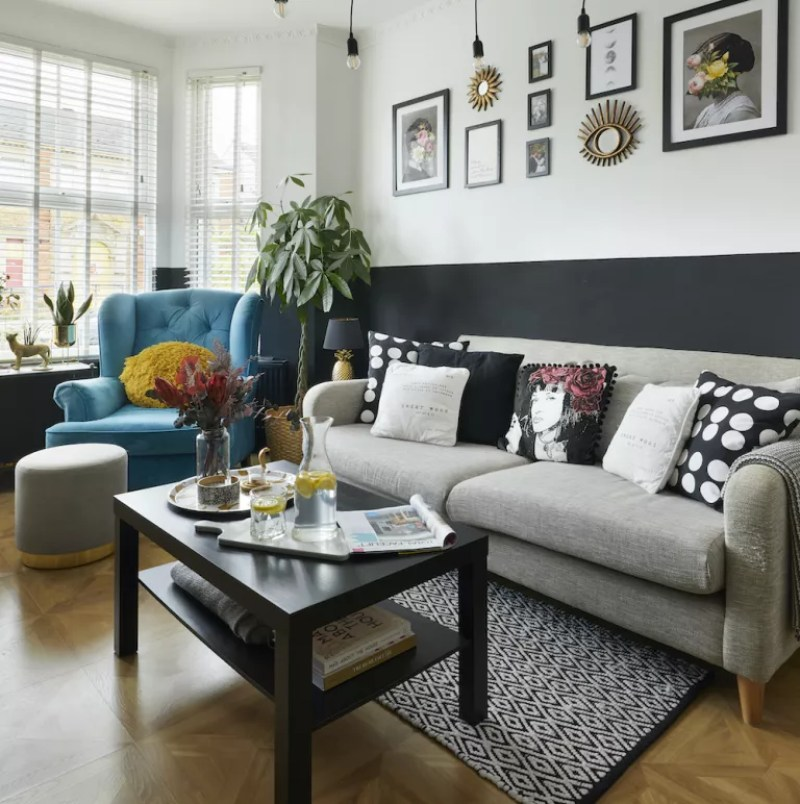 Monochrome living room, turquoise armchair grey sofa and black coffee table