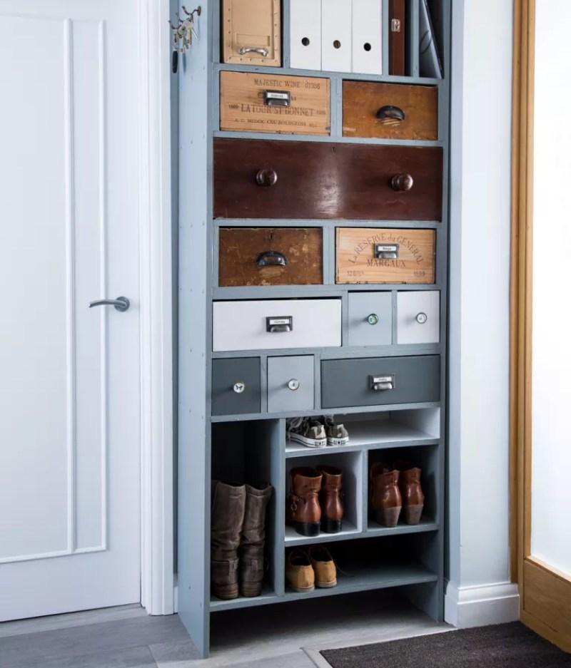 Pale blue vertical storage unit in white narrow hallway