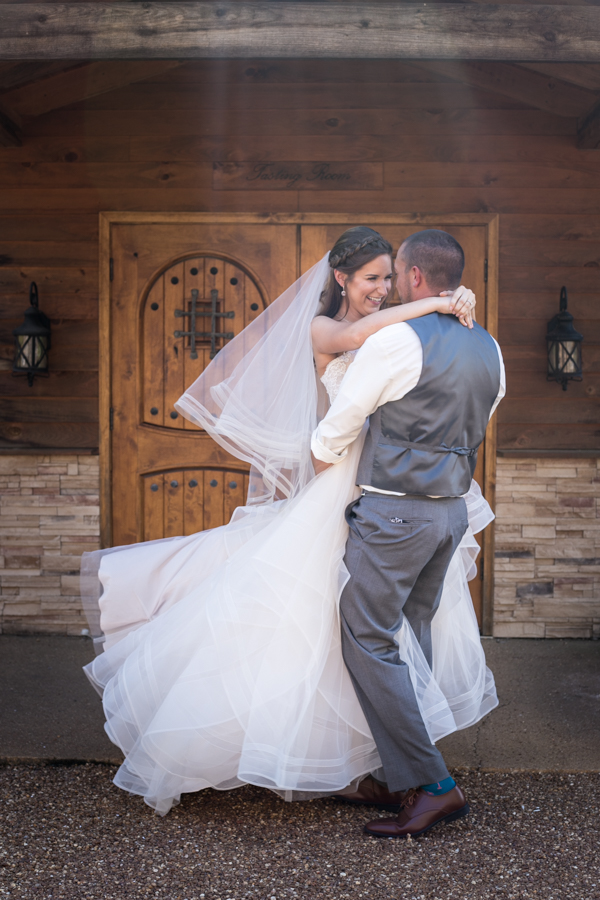 groom spinning his bride