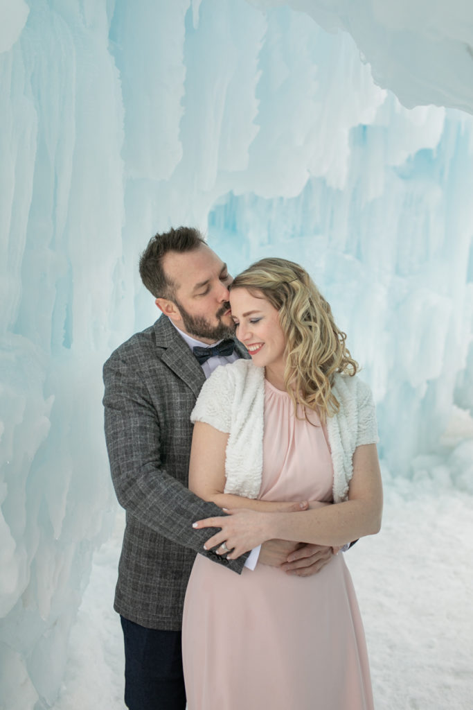couple snuggling up at the ice castles in excelsior