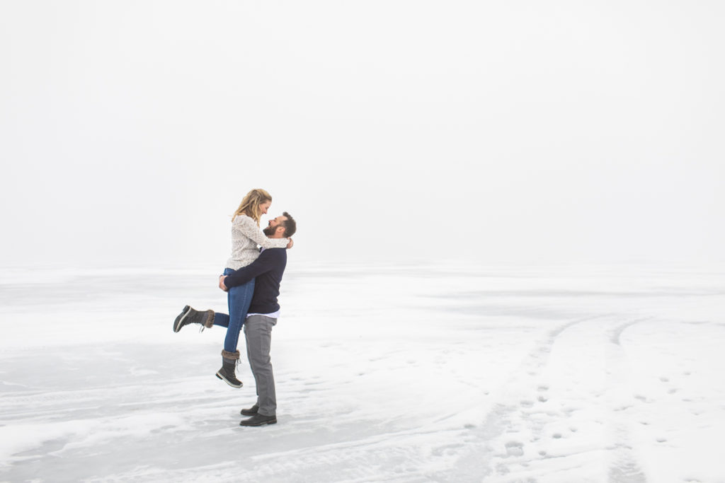 engagement photos in dense fog on lake minnetonka